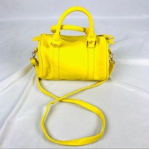 Charming Charlie's bright yellow crossbody purse
